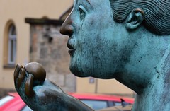 Beauty with apple (:Linda:) Tags: germany thuringia franconia town bamberg metal woman hand apple face copper