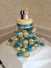 Turquoise and cream wedding cupcake tower (Little Miss Cupcakes) Tags: flowers wedding tower turquoise cream cupcake warwick warwickshire leamingtonspa stratforduponavon kenilworth littlemisscupcakes