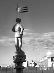 Statue (afortiorama) Tags: light bw sun white black mountains alps rooftop statue tetto milano spire duomo statua guglia