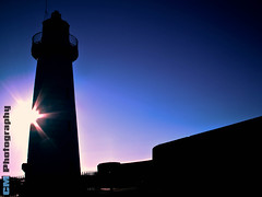 Light in a dark place (C.M_Photography) Tags: light lighthouse silhouette dark flare donaghadeelighthouse