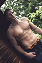 (Joderzz) Tags: sun man men beach water fashion pose magazine spread log cabin woods snake page topless editorial lumberjack narrative moores superdry