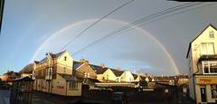 Full rainbow over Porthcawl (Tim Bow Photography) Tags: street houses light urban weather wales clouds dark photography rainbow phone 5 stormy full bow welsh raining porthcawl fullrainbow cameratim photographyiphoneiphone