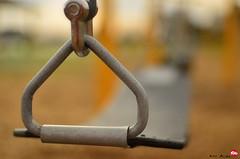 Lonely Swing (Red Weasel Media) Tags: playground nikon dof bokeh noflash swing vabeach virginiabeach nikon35mm rwm magicbullet kirkallen nikon35mm18 nikond5100 redweaselmedia