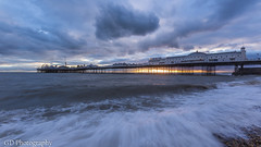 Palace Pier (GlennDriver) Tags: city uk sunset sea england seascape tourism beach water clouds photography sussex evening coast pier brighton cloudy britain wave pebbles east gb
