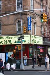 Mr Tang (wyojones) Tags: street nyc newyorkcity people usa signs newyork men corner restaurant garbage women chinatown manhattan parking sidewalk pedestrians oneway fruitstand lightpole mottstreet bayardstreet mrtang wyojones