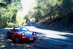 Top Down, Headlights Up (Mr Pika) Tags: convertible mazda miata mx5 roadster forestroad eunos redconvertible popupheadlights redsportscar
