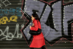 A woman in red coat walks in front of  a graffiti.Greece (aggelikikoronaiou) Tags: life street city red people urban woman cold color wall walking graffiti downtown coat lifestyle streetlife pedestrian athens greece trench trenchcoat walker hurry passage society passerby socialdocumentary reportage urbanlife urbanphotography passingby socialreportage colorfulgraffiti
