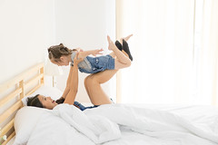 Family concept. Daughter having the best time with mom in bedroom at home (MongkolChuewong) Tags: air beatiful bed bedchamber best care childhood children crazy cute daughter family fun funny game girl happiness happy home house joy jump jumping kid kids laughing little love mom morning mother parenting people pillow plant playful playing room small smile smiling time toddler together togetherness white young