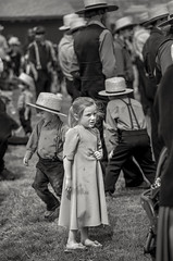 Alone in a crowd (crabsandbeer (Kevin Moore)) Tags: amish childhood farm kids mennonite mudsale pa pennsylvania people play rural spring bw monochrome street child children person candid