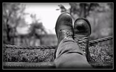 Lazy (J Michael Hamon) Tags: blackandwhite bw monotone achromatic foot feet shoe shoes boot boots lazy relax hamon nikon d3200 nikkor 35mm vignette photoborder leisure flickrelite