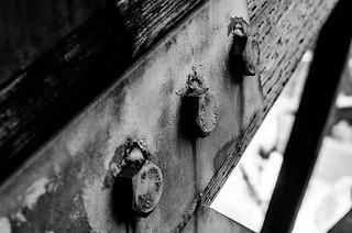Three bolts on a bridge