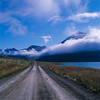 Road, clouds and mountains