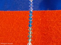Blau Orange Macro Monday (magritknapp) Tags: macromonday orangeandblue2blaue seideoranges filsblaue kette aus swarowski perlen blue silk oranges fils necklace from swarovski pearls collier bleu soie de orange perles cristal naranja seda azul collar perlas