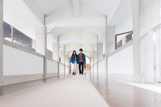 Young couple walking in white corridor in the morning