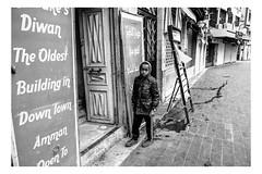 A child is seen in the Amman downtown (Roman Lunin) Tags: amman jordan street streetphotography streetphoto strangers child children black blackandwhite streetblackwhite bw streetbw monochrome outside arab candid walkby