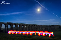 Rainbow & Viaduct (Gavmonster) Tags: nikon nikond7000 d7000 gswphotography landscape clouds sky land viaduct balcombe sussex uk unitedkingdom arches train railway lighttrails lightpainting moon gradeiilisted pixelstick longexposure grass bridge ousevalley london brighton blue gold green 30seconds swirls leadinglines westsussex night evening rainbow red orange pink