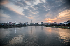 A Beautiful Sunset (MH Photograaphy) Tags: ngc sunset hatirjheel dhaka bangladesh river lake canal mogbazar rough sky skyview wired pylon electricgiant shadow boatwave boating