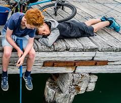 Fishing (pbradyinct) Tags: newzealand akaroa boys fishing pier blue red redhead