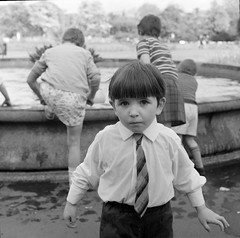 That pudding bowl haircut just never goes out of style... (National Library of Ireland on The Commons) Tags: park ireland boy dublin playing fountain shirt children tie 1960s 20thcentury sixties 1964 ststephensgreen stephensgreen bulrushes puddingbowl leinster nationallibraryofireland elinorwiltshire wiltshirephotographiccollection