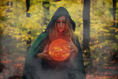 plasma (Vanessa Vokey) Tags: trees light sun green forest ball fire star holding candle witch wizard smoke magic flame elements smokey hood cloak conceptual