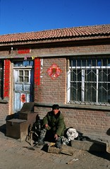 Village shoemaker in province Nei Mongol (Frhtau) Tags: china winter house man building brick stairs work asian shoe asia village north decoration hard east repair worker province nei mongol