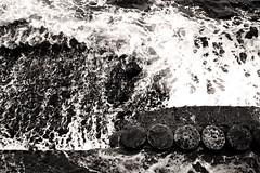 Chaotic Seas (Triple_B_Photography) Tags: world ocean above travel shadow sea vacation blackandwhite bali holiday motion blur texture tourism beach nature water lines weather rock closeup contrast photoshop altered canon indonesia asian concrete island eos coast seaside interesting intense energy asia paradise experimental surf waves afternoon zoom stones tide curves laut grain shoreline warmth sealife location tourist explore coastal filter shore elements tropical destination essence noise emotions tropics enhanced adjustment alternative edit pantai intensity balinese amped 500d tulamben 2013 elementsorganizer