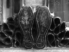 Gloucester Cathedral [Explored] (pefkosmad) Tags: blackandwhite bw white black feet monochrome graffiti mono shoes cathedral praying tomb gloucestershire gloucester figure bishop gloucestercathedral effigy ladychapel godfreygoldsborough northchantry