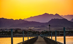 the Jetty will be closed at sunset (werner boehm *) Tags: wernerboehm sunset nabqbay egypt sinai jetty perspective mountains beach strand reflection redsea rotesmeer