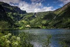 The fjord of the eagle (wimvandemeerendonk, quite busy at the moment with ) Tags: arnafjord norway panorama water waterfall waterfalls contrast color colors colours colour clouds cloud forest fjord sognefjord green hill hills landscape mountain monumental mountainscape minolta nature outdoors outdoor reflection rock rocks ripples sony sky snow tree trees valley wimvandem wild wetlands waves wave bright blue flower flowers falls umbelliferae light sun scenic w greatphotographers