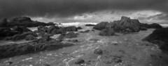 Glass Beach #2 (LowerDarnley) Tags: anscopixpanorama flippedlens 35mmfilm panorama glassbeach fortbragg california ocean rocks beach waves storm sky clouds northernca