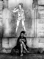 Street - Two girls (François Escriva) Tags: street streetphotography paris france olympus omd candid people girls women book bag reading suicide picture fascist gun contrast black white bw noir blanc nb photo rue elenaferrante lamicageniale mybrilliantfriend lamieprodigieuse