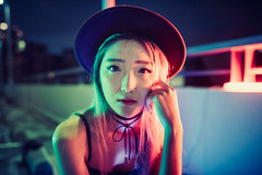 Neon Glow (Jon Siegel) Tags: nikon d810 24mm sigma sigma24mmf14 14 sigma24mmf14art woman girl hat fashion style beautiful beauty portrait portraiture neon experimental chinese singapore singaporean people rooftop