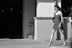 Breaking In New Heels (burnt dirt) Tags: houston texas downtown city town mainstreet sidewalk street corner crosswalk streetphotography xt1 fujifilm bw blackandwhite girl woman people person asian heels stilettos shortdress glasses sunglasses longhair windy