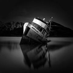 Nirvana (Dan Moran AK) Tags: derelict dutchharbor unalaska alaska pacificocean aleutians fishingboat mountains blackandwhite longexposure reflection nirvana nikon d750 tamronsp2470mmf28divcusd tamron 2470