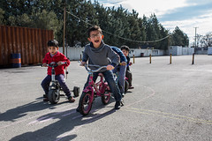 playing (dominic_wenger) Tags: greece sindos thessaloniki athen frakapor refugee refugees refugeecamp camp military crysis borders open world problem swisscross volunter help portrait face family poor man woman kids chil child children beautiful beauty war syria tent tents hall light dark cold candid looking people human humanity sun boring life flee volunteer frame sigma35 sigma canon 5dmk3 lowlight sigmaart mother daughter buggy small babx baby smart cute smile sunshine blue sky warm shaddow personen