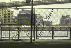 "Dancing Outline On Link Fence At East River Waterfront (nrhodesphotos(the_eye_of_the_moment)) Tags: dsc0789772 ""theeyeofthemoment21gmailcom"" ""wwwflickrcomphotostheeyeofthemoment"" eastriver caractertures figures linkfence spring2017 spring season nyc manhattan brooklyn bridge fence metal creative outlines waterfront walkway architecture buildings pole shadows reflections les roadway sign"