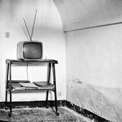 End of transmissions (Italian Film Photography) Tags: television abandoned old blackandwhite bw biancoenero bn film pellicola shelf analogica square quadrato silver scaffale abbandono empty room stanza vuota analogue