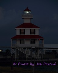 Lighthouse at Dawn (jogiporche) Tags: lighthouse lakepontchartrain dawn beacon clouds