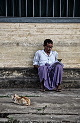 The man and the cat (isabelle.giral) Tags: mawlamyine birmanie burma myanmar cat chat lecteur homme man pentax reader