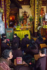 Praying (Five Second Rule) Tags: vietnam hanoi 2017 praying meditation religon buddhism buddha gold shrine kneeling altar