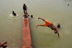 Taking a plunge (Rajib Singha) Tags: travel street people portrait river fun children joy interestingness flickriver ahiritola kolkata westbengal india