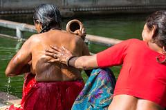 Holy water bathing (@jo_did_this) Tags: monkeytemple galtaji india jaipur women washing bathing wash bathe holywater friends helping water pot bareskin rinse wet
