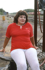 Well pleased, 1994 (clarkfred33) Tags: railroadyard wildwood 1994 railroadadventure redandwhite whitepants wetpants wetfun wetwoman wetlook sitting smug expression railroadscene