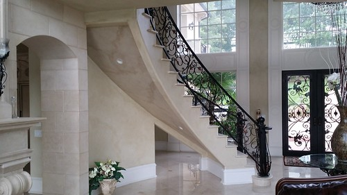 Curved stair by Andronic's Construction in Charlotte NC
