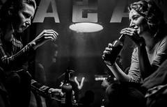 Pasaz (framespotter) Tags: girls monochrome blackandwhite bottle alcohol drink light window bar smile candid night panasonic nikon nikkor gx7 35mm