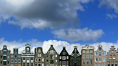 the sky over amsterdam (amsterdam, netherlands) (bloodybee) Tags: 365project amsterdam netherlands holland europe skyline house building architecture roof window sky clouds blue white brown