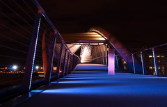 Amgen Footbridge (Gabriel Tompkins) Tags: seattle longexposure bridge sky lines architecture night washington nikon purple footbridge queenanne lavender lensflare flare belltown pacificnorthwest nikkor washingtonstate pnw 2009 emeraldcity starburst pedestrianbridge 18105 converginglines d90 starpoints 18105mm nikond90 amgenhelix 18105mmf3556gvr elliottbaytrail tronam gabrieltompkins