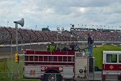 "even our ""every day heroes"" got to relax a bit that day... HFF! (IndyEnigma) Tags: people car clouds fence track indianapolis indiana firetruck nascar fans firefighter grandstand hff firstresponder indianapolismotorspeedway brickyard400"