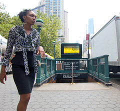 Woman by the Subway (UrbanphotoZ) Tags: nyc newyorkcity blackandwhite woman ny newyork subway manhattan broadway dalmation uptown upperwestside africanamerican 1train lincolncenter 66st duckingdiving tuckersquare