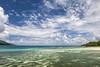 """Heaven on Earth and Sea"" (helmet13) Tags: d700 raw seychelles landscape seascape nature indianocean colors lagoon silence sky clouds width aoi heartaward peaceaward platinumpeaceaward 100faves world100f simplicity"